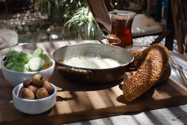 Kahve 6 @ 13 Anahtar Sokak - Izmir kahvealti (melted Tulumi cheese w Simit, cottage cheese w mulberry jam, olives, cucumbers, tomatoes)k64