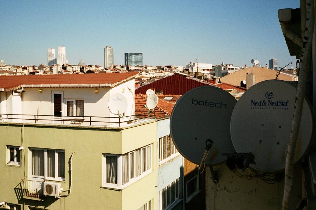 Buildings all over the city are dotted with satellite dishes