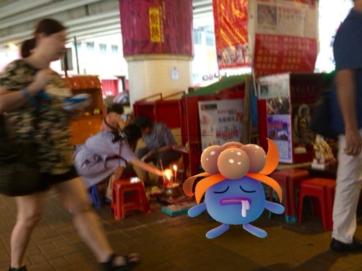 Gloom pokemon with the villian hitters (打小人) under the flyover in Causeway Bay