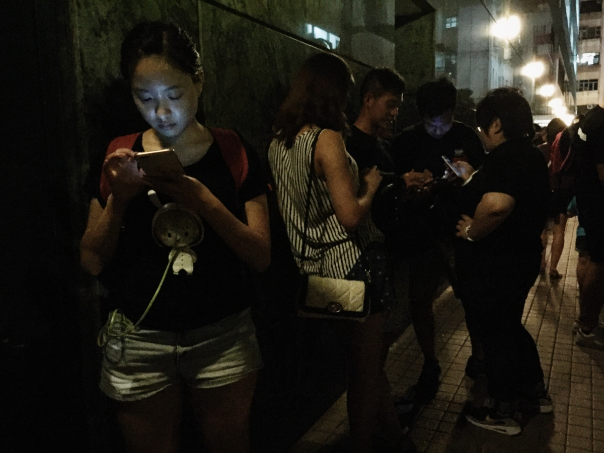 Pokemon GO trainers gathered at a PokeStop